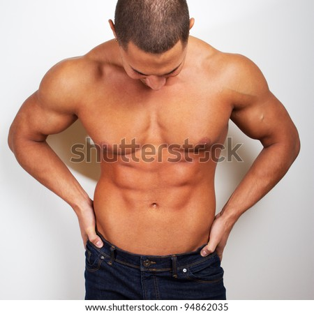 Image of sexy strong man in jeans - stock photo