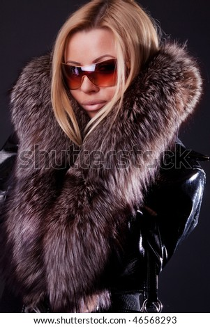 Image of sexy woman wearing expensive coat - stock photo