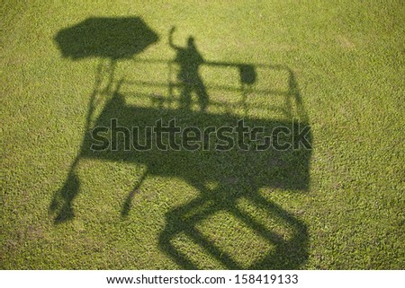 image of shadow of  a worker on high work place, the outline of a man and umbrella,