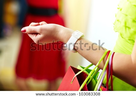 Image of shopaholic arm with colorful shopping bags - stock photo