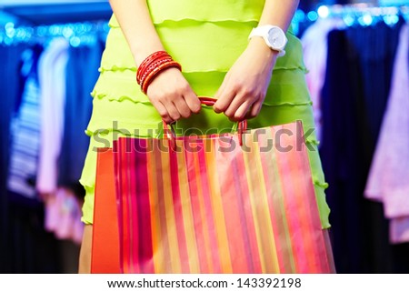 Image of shopaholic hands with shopping bags - stock photo