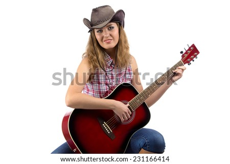 Image of sitting cowgirl with the guitar on white background - stock photo
