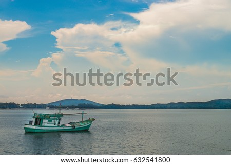 Image of small boat fishing on the sea