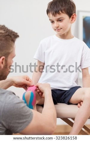 Image of small happy boy during kinesiology therapy - stock photo