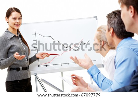 Image of smart business woman looking at their partners while she explaining something on whiteboard