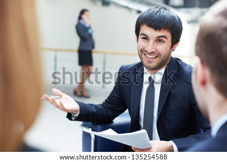 Image of smart businessman voicing his opinion or idea to colleagues - stock photo