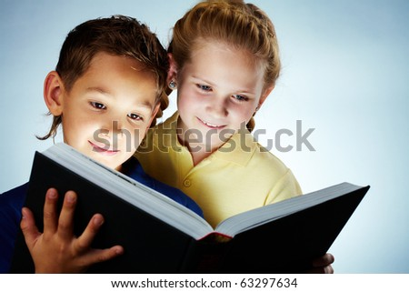 Image of smart children reading interesting book - stock photo