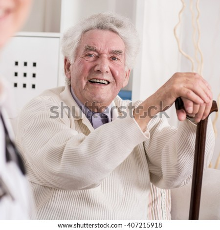 Image of smiling rich old man and his private medic - stock photo