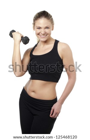 Image of smiling woman holding dumbbells against white background