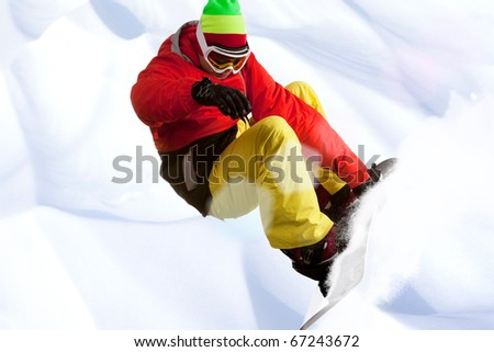 Image of snowboarder skating down mountain side - stock photo