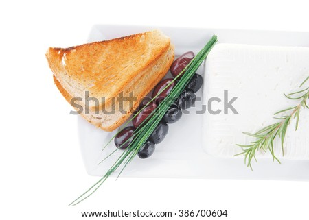 image of soft feta cube and bread toast on plate - stock photo