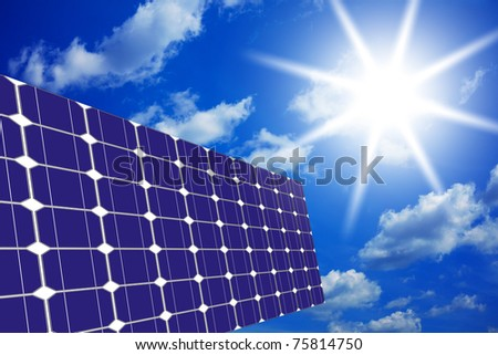Image of solar panels - clean energy source on the background of sky and bright sun
