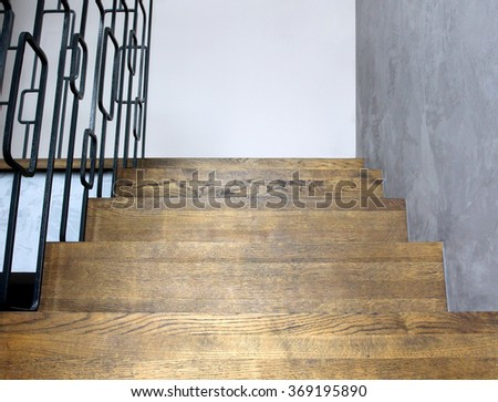 Image of solid wooden stairs with elegant metal balustrade - stock photo