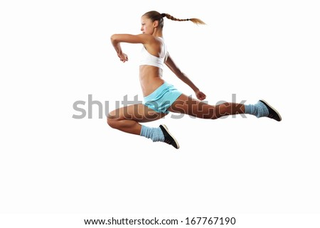 Image of sport girl in jump against white background - stock photo