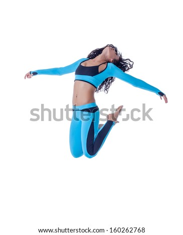 Image of sporty young brunette posing in jump - stock photo