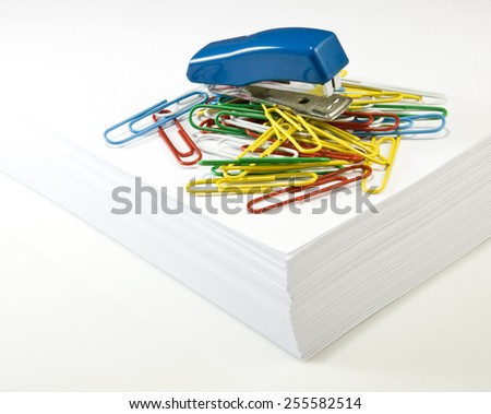 image of stacks of paper, stapler and clips closeup - stock photo