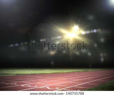 Image of stadium in lights and flashes - stock photo