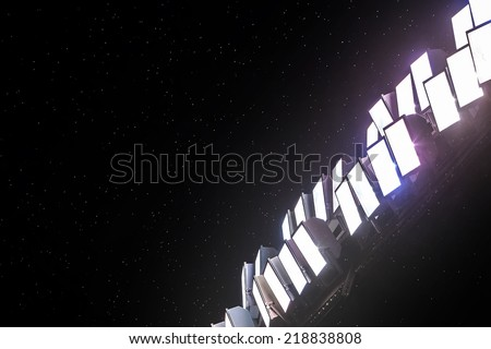 Image of stadium in lights and raining - stock photo