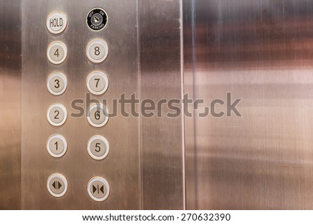 image of stainless steel elevator panel push buttons. - stock photo