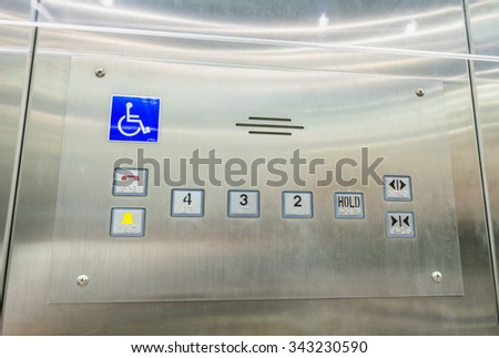 image of stainless steel elevator panel push buttons for blind and disability people - stock photo