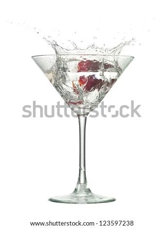 Image of strawberry splash into cocktail against white background - stock photo