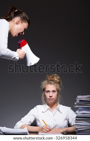 Image of stressed young female workplace bullying victim  - stock photo