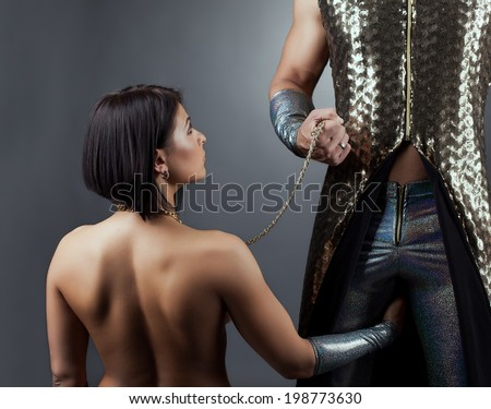 Image of strict man holding his partner on leash - stock photo