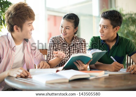 Image of students preparing for the seminar together - stock photo