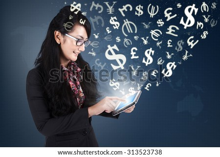 Image of successful female entrepreneur making money online with an internet connection and digital tablet - stock photo