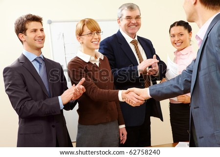 Image of successful handshake after business training - stock photo