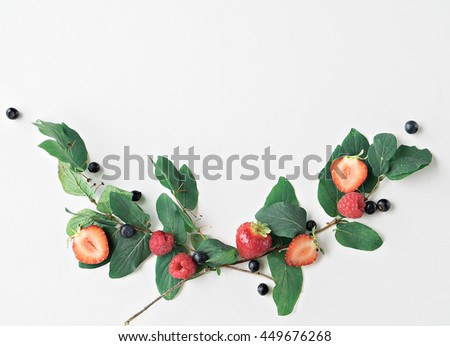 image of summer berries on blue wooden background