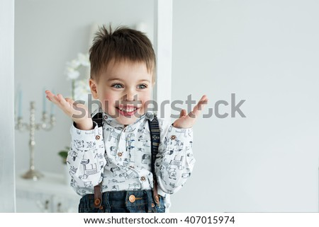 Image of  sweet baby boy, closeup portrait of child isolated on white background, cute toddler with blue eyes - stock photo