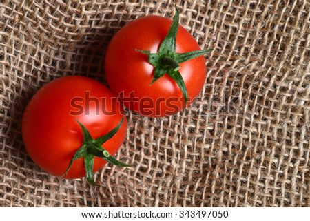 Image of tasty tomatoes with storks