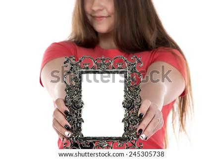Image of teenage girl showing photo frame on white background - stock photo