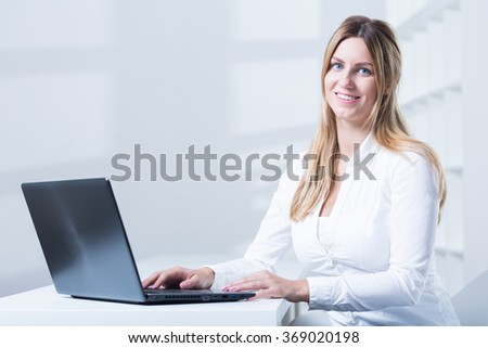 Image of tele consultant with laptop during work - stock photo