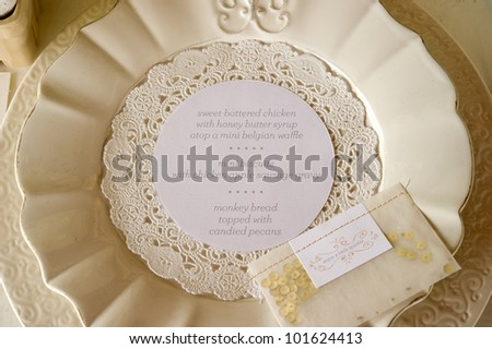 Image of the dinner menu on a plate at wedding reception