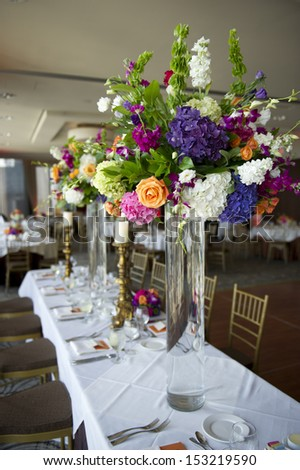 Image of the head table at a wedding with florals - stock photo