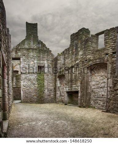 Image of the inside shell of Craigmillar castle ruin in Edinburgh, Scotland. - stock photo
