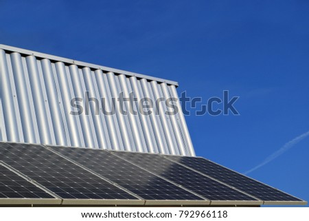 Image of the solar battery on the wall against the sky.