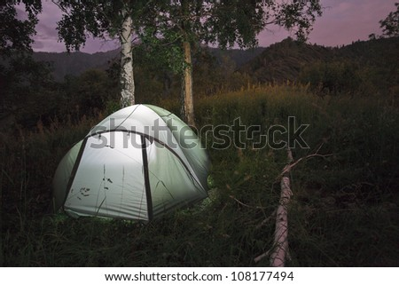 Image of the tent camp with night lighting flashlight in mountains of Almaty, Kazakhstan - stock photo