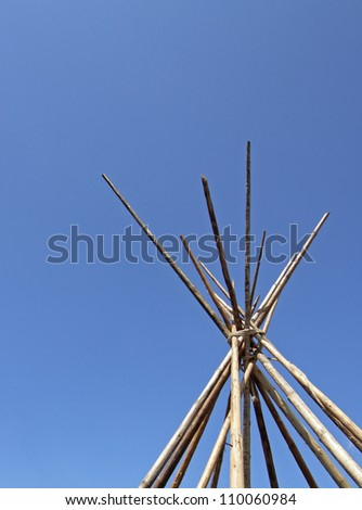 image of the top of a wood abandoned indian tent - stock photo