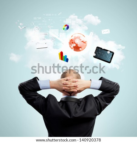 Image of thoughtful businessman standing with back - stock photo