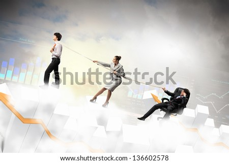 Image of three businesspeople with rope against diagram background - stock photo