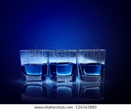 Image of three glasses of blue liquid - stock photo