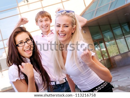 Image of three happy businessmen near office building - stock photo