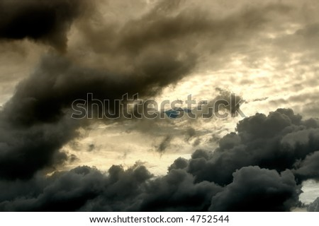 Image of thunder clouds and sun shining through