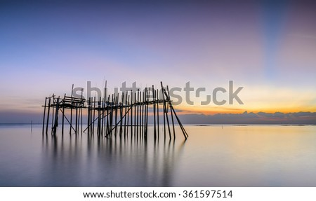 Image of traditional fishermen timber and bamboo jetty known as LANGGAI  during sunset