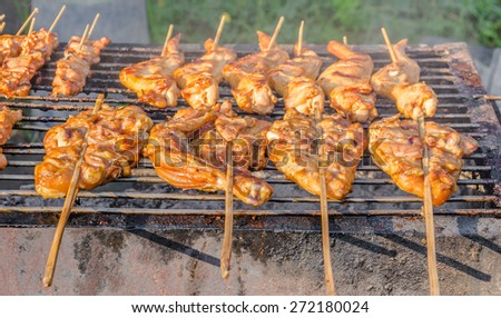 image of Traditional roasted chicken stick on grill, Thailand. - stock photo