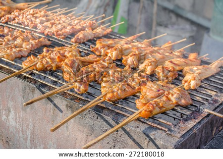 image of Traditional roasted pork stick on grill, Thailand. - stock photo