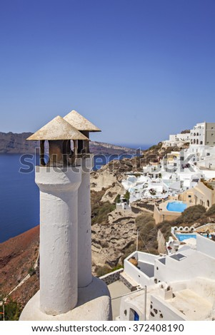 Image of traditional whitewashed chimney commonly found in Greece. Oia, Santorini.  - stock photo